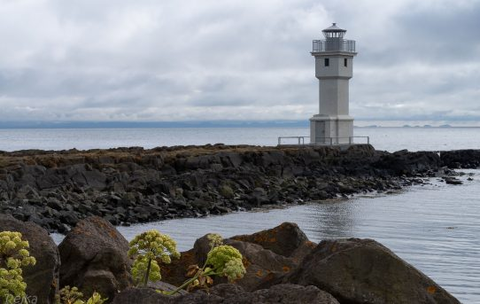small white lighthouse in Akranes town on Iceland