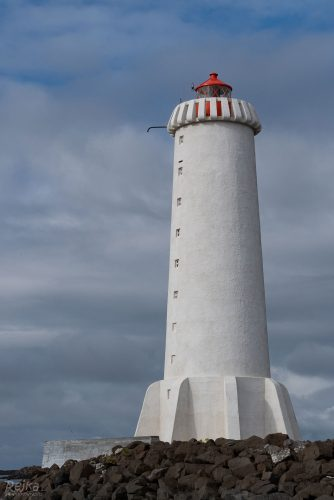 bigger lighthouse with red lamp in Akranes town on Iceland
