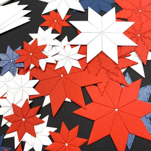 jednobarevné osmicípé hvězdy složené z vyřezaných kosočtverců