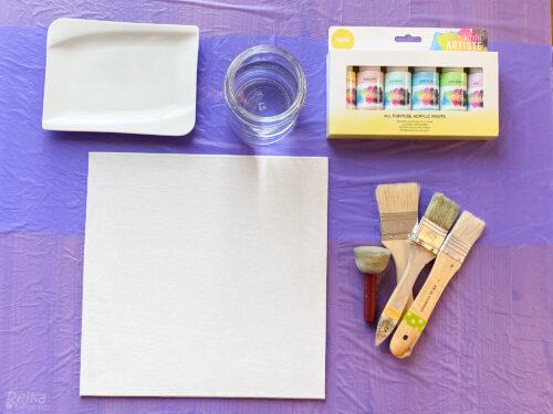 plátno, barvy a štětce - příprava na obraz s mandalami